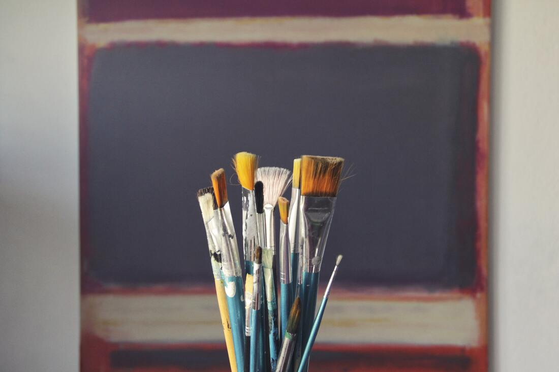 Artist's blank canvas and paint brushes